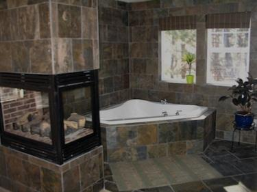 custom bathroom with fireplace and jacuzzi